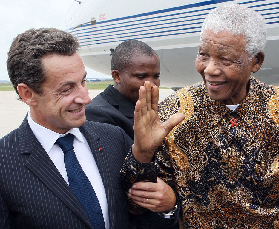 . French President Nicolas Sarkozy, left, welcomes former South African president Nelson Mandela, right, upon his arrival, at Paris Orly airport, Monday, Sept. 3, 2007. Mandela is on a three-day visit to Paris. (AP Photo/Thomas Coex, Pool)