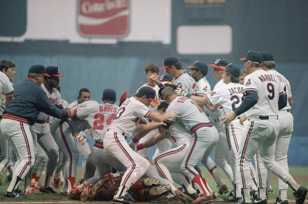 . The Cleveland Indians and the California Angels mix it up after Angel batter Devon White was hit by a pitch precipitating the bench-clearing brawl, Friday, July 9, 1988, Cleveland, Ohio. The Angels went on to score 8 runs in the inning route to a 10-6 win. The players are unidentified. (AP Photo/Mark Duncan)