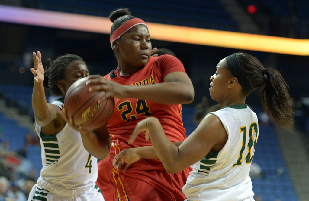 . Etiwanda\'s Amy Okonkwo defends her rebound at Citizens Business Bank Arena in Ontario, CA on Saturday, March 22, 2014. Long Beach Poly vs Etiwanda in the CIF girls open division regional final. 1st half, Photo by Scott Varley, Daily Breeze)