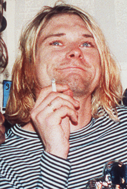 ". Lead singer of Nirvana Kurt Cobain is shown in a 1993 file photo. Cobain, who raked in a posthumous $50 million between October 2005 and October of this year, has edged Elvis Presley from the No. 1 spot on Forbes magazine\'s annual list of ""Top-Earning Dead Celebrities.\"" He committed suicide in 1994.(AP Photo/Mark J.Terrill)"