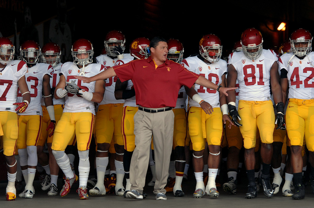 . Defensive line coach Ed Orgeron holds back his players in the tunnel before coming onto the field for USC\'s Spring Football Game at the L.A. Memorial Coliseum, Saturday, April 13, 2013. (Michael Owen Baker/Staff Photographer)