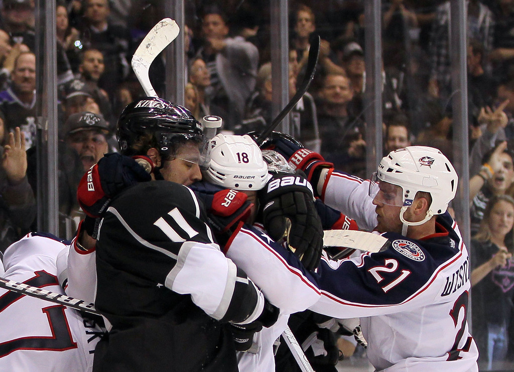 . LOS ANGELES, CA - APRIL 18:  Anze Kopitar #11 of the Los Angeles Kings and R.J. Umberger #18 of the Columbus Blue Jackets get in a tussle after their NHL game at Staples Center on April 18, 2013 in Los Angeles, California. The Kings defeated the Blue Jackets 2-1.  (Photo by Victor Decolongon/Getty Images)