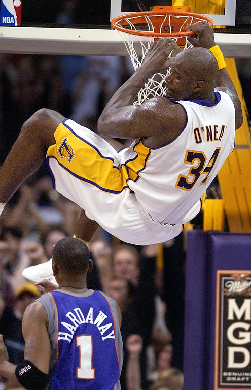 . Los Angeles Lakers\' Shaquille O\'Neal looks down on Phoenix Suns\' Anfernee Hardaway after dunking the ball during the first half, Sunday night, Jan. 5, 2003, in Los Angeles. O\'Neal scored 36 points in their 109-97 win over the Suns. (AP Photo/Mark J. Terrill)