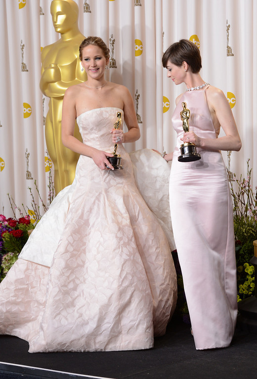 Description of . Oscar winners Jennifer Lawrence and Anne Hathaway backstage at the 85th Academy Awards at the Dolby Theatre in Los Angeles, California on Sunday Feb. 24, 2013 ( David Crane, staff photographer)