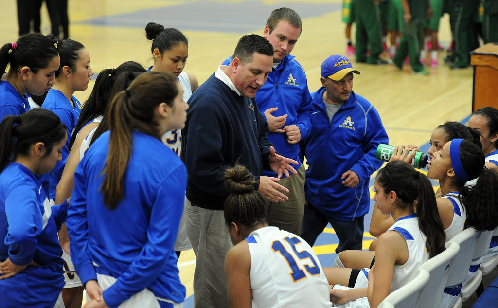 Description of . Bishop Amat head coach Richard Wiard talks to his team during a time-out in the second half of a CIF State Southern California Regional semifinal basketball game against Long Beach Poly at Bishop Amat High School on Tuesday, March 12, 2013 in La Puente, Calif. Long Beach Poly won 52-34.  (Keith Birmingham Pasadena Star-News)