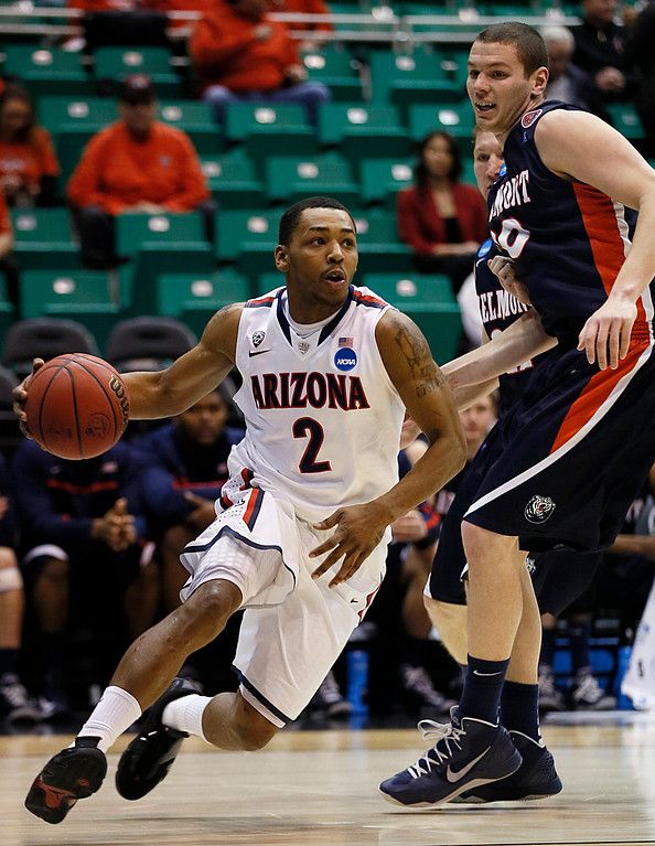 . Arizona\'s Mark Lyons, left, drives around Belmont\'s Trevor Noack during the first half of a second-round game in the NCAA college basketball tournament in Salt Lake City Thursday, March 21, 2013. (AP Photo/George Frey)
