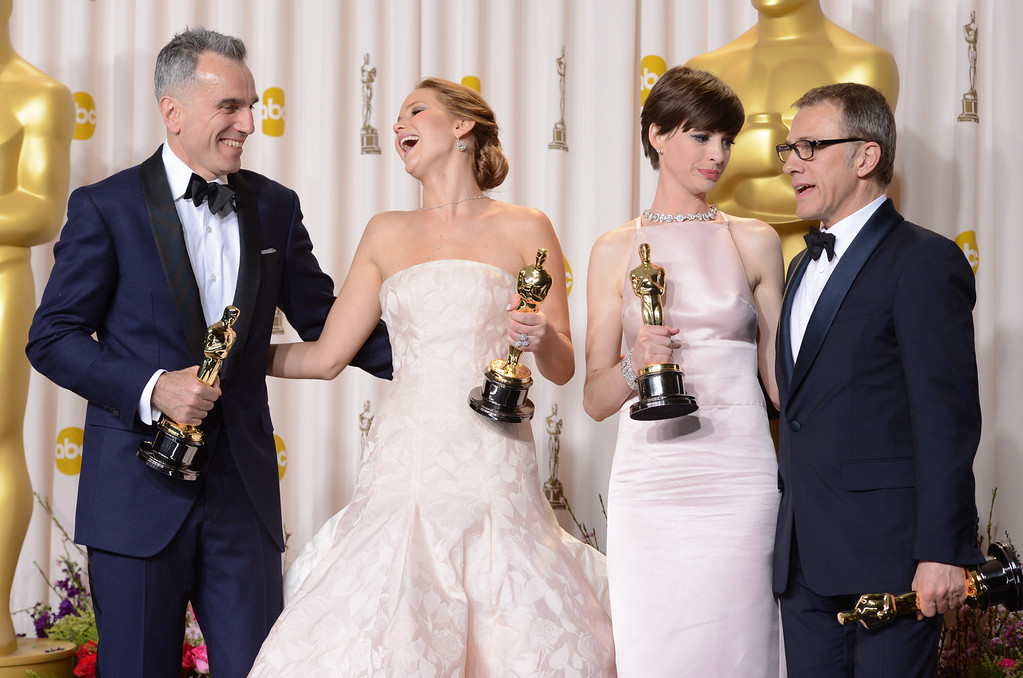 Description of . Oscar winners Daniel Day-Lewis, Jennifer Lawrence, Anne Hathaway  and Christoph Waltz  backstage at the 85th Academy Awards at the Dolby Theatre in Los Angeles, California on Sunday Feb. 24, 2013 ( David Crane, staff photographer)