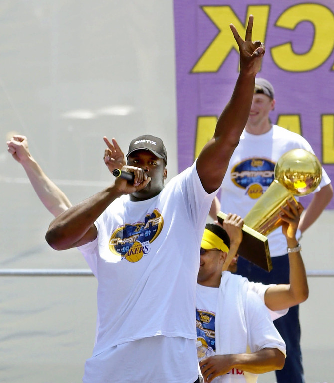 . Los Angeles Lakers\' Shaquille O\'Neal signals two fingers for back-to-back championships as he performs a rap song during the Lakers victory celebration at Staples Center Monday, June 18, 2001, in Los Angeles. The Lakers defeated the Philadelphia 76ers to win their second consecutive  championship. (AP Photo/Kevork Djansezian)