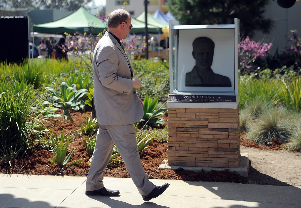 . Dr. Kenn Pierson walks past the statue of former president Dr. Phil Putnam during a celebration of the colleges 50th anniversary with a time capsule burial, cake and signing of a giant birthday card at Rio Hondo College on Thursday, March 14, 2013 in Whittier, Calif.  (Keith Birmingham Pasadena Star-News)