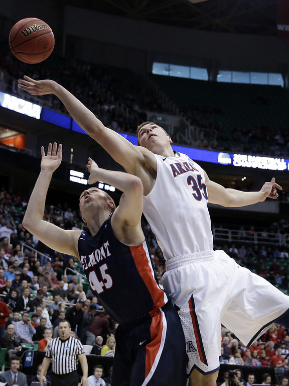 . Arizona\'s Kaleb Tarczewski (35) and Belmont\'s Brandon Baker (45) vie after a rebound during the first half in a second-round game in the NCAA college basketball tournament in Salt Lake City Thursday, March 21, 2013. (AP Photo/Rick Bowmer)
