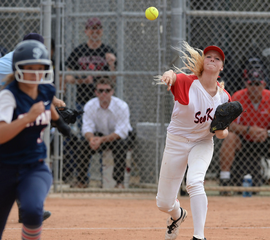 . Palos Verdes\' Johniann Wahl (44) makes the out at first on St. Paul in a CIF-SS Division III semifinal softball game Tuesday, May 27, 2014, Palos Verdes Estates, CA.   Palos Verdes lost 10-0. Photo by Steve McCrank/Daily Breeze