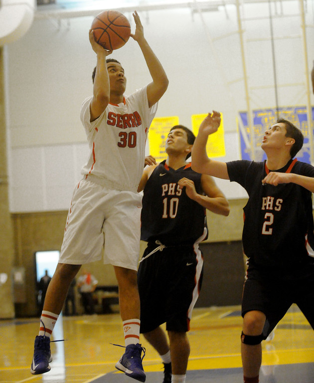 . 03-12-2013--(LANG Staff Photo by Sean Hiller)-Serra\'s Cedric Thomas goes to the basket against Pacific Hills\' James Casanova (10) and Adam Plax (2) in Tuesday\'s boys basketball IV Southern California Regional semifinal at L.A. Southwest College.