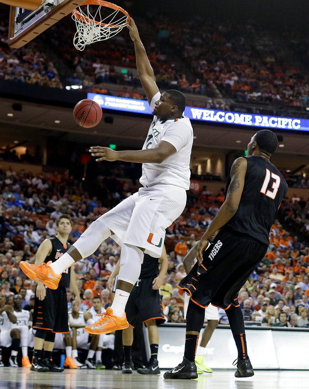 . Miami\'s Reggie Johnson dunks over Pacific\'s Khalil Kelley (13) during the second half of a second-round game of the NCAA college basketball tournament Friday, March 22, 2013, in Austin, Texas. Miami beat Pacific 78-49. (AP Photo/Eric Gay)