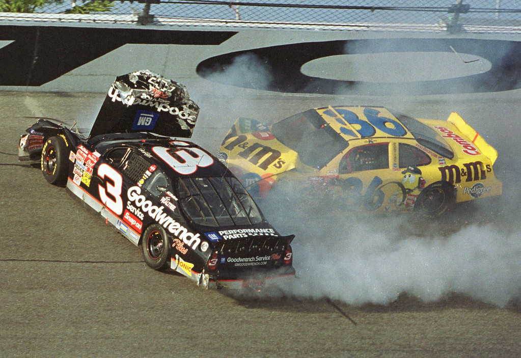 . ** FOR USE AS DESIRED, PHOTOS OF THE DECADE ** FILE - Ken Schrader (36) slams into Dale Earnhardt (3) during the Daytona 500, in this Feb. 18, 2001 file photo, at the Daytona International Speedway in Daytona Beach, Fla.  Earnhardt was killed in the crash.  (AP Photo/Glenn Smith, File)