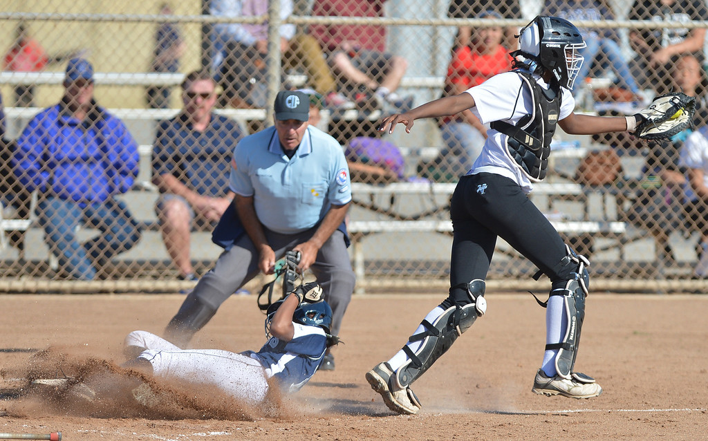 . 0314_SPT_TDB_L_CAR-NORTH--- Torrance, CALIFORNIA--3/13/13--- Staff Photo: Robert Casillas / LANG--- Carson at North Torrance softball. North\'s Lexi Hendon scores as Carson catcher Hillary Edior reaches for wide throw at home.