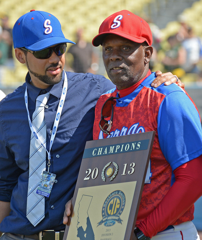 . Serra principal Christian De Larkin, left, and coach Wil Aaronhold their new championship plaque after beating Mira Costa in the CIF-SS Division III championship baseball game Friday at Dodger Stadium. Serra won the title, 8-1. 20130531 Photo by Steve McCrank / Staff Photographer