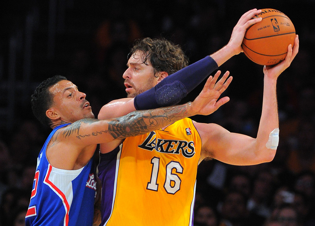 . Pau Gasol keeps the ball from Matt Barnes in the NBA season opener between the Lakers and Clippers at Staples Center in Los Angeles, CA on Tuesday, October 29, 2013.  Lakers won 116-103. (Photo by Scott Varley, Daily Breeze)