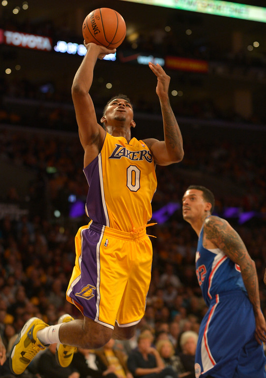 . Lakers#0 Nick Young goes to the hoop in the 4th. The Los Angeles Lakers defeated the Clippers 116 to 103 in the opening game of the season at Staples Center. Los Angeles, CA. 10/29/2013. photo by (John McCoy/Los Angeles Daily News)