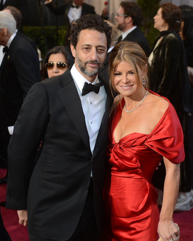 . Grant Heslov and his wife, Lisa, arrive at the 85th Academy Awards at the Dolby Theatre in Los Angeles, California on Sunday Feb. 24, 2013 ( Hans Gutknecht, staff photographer)