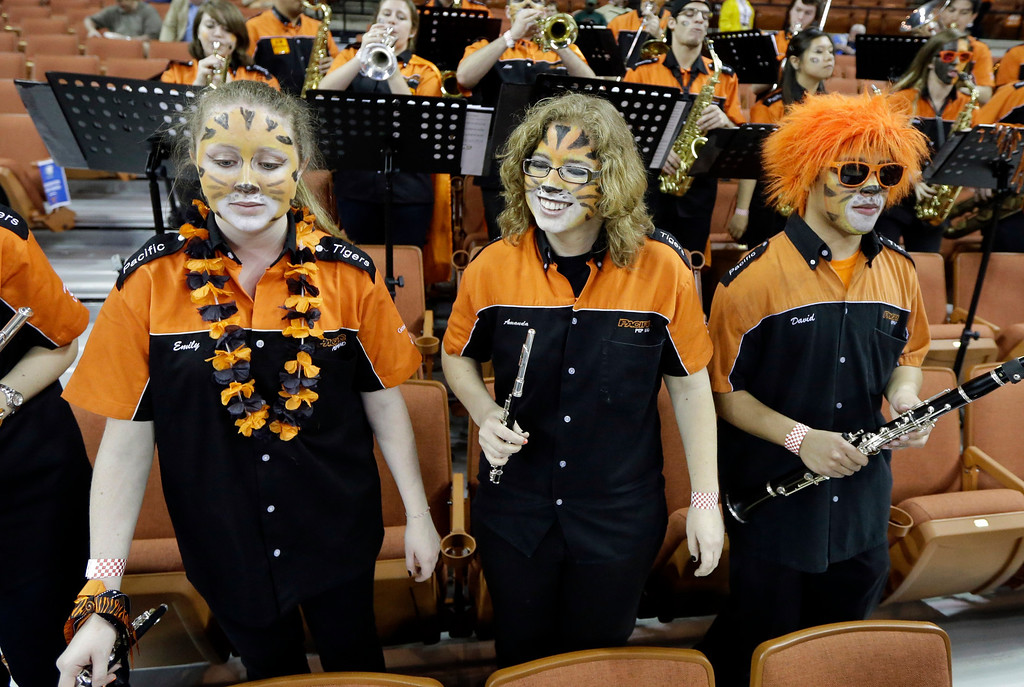 . Pacific band members play before a second-round game of the NCAA college basketball tournament against the Miami Friday, March 22, 2013, in Austin, Texas.  (AP Photo/David J. Phillip)