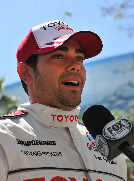 . 4/19/13 - Jesse Metcalfe gives an interview after the Friday morning practice of the Toyota Pro/Celebrity race at the 39th Annual Toyota Grand Prix of Long Beach. Photo by Brittany Murray / Staff Photographer