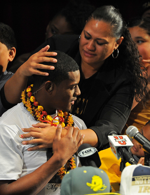""". Following his announcement that he will play football at USC, Long Beach Poly football player John \""""JuJu\"""" Smith gets a hug from his mother in Long Beach, CA on Wednesday, February 5, 2014. (Photo by Scott Varley, Daily Breeze)"""