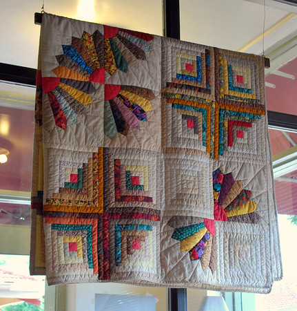 A quilt hanging on display in Big Ed's