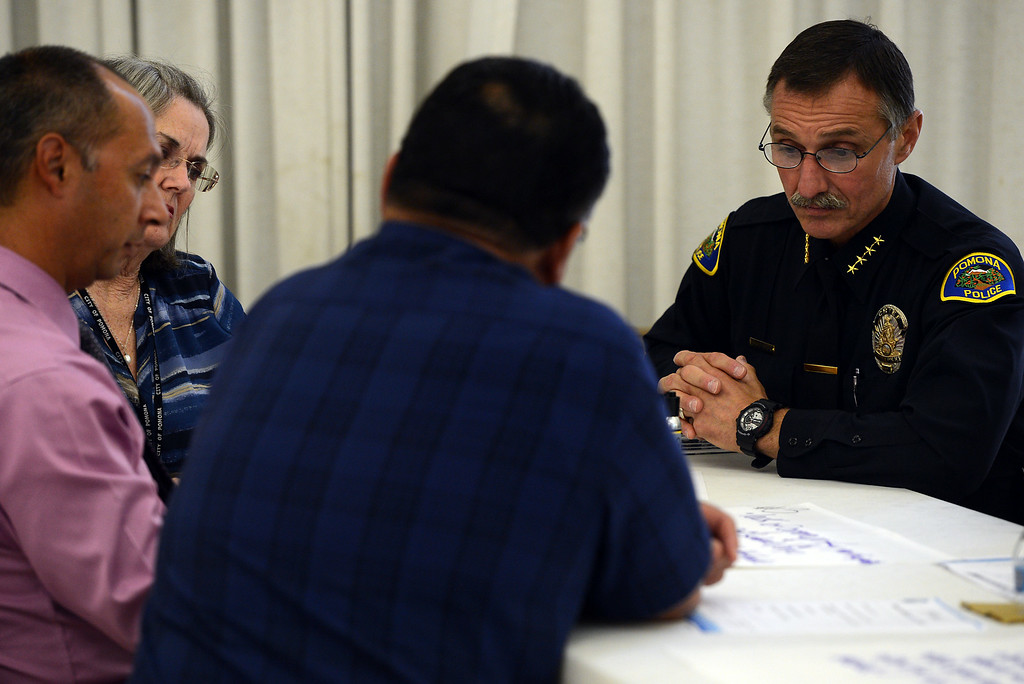 Description of . Community members attend Pomona's Promise Public Safety Summit at the Ganesha Park Community Center in Pomona, CA, Wednesday, August 13, 2014. (Photo by Jennifer Cappuccio Maher/Inland Valley Daily Bulletin)