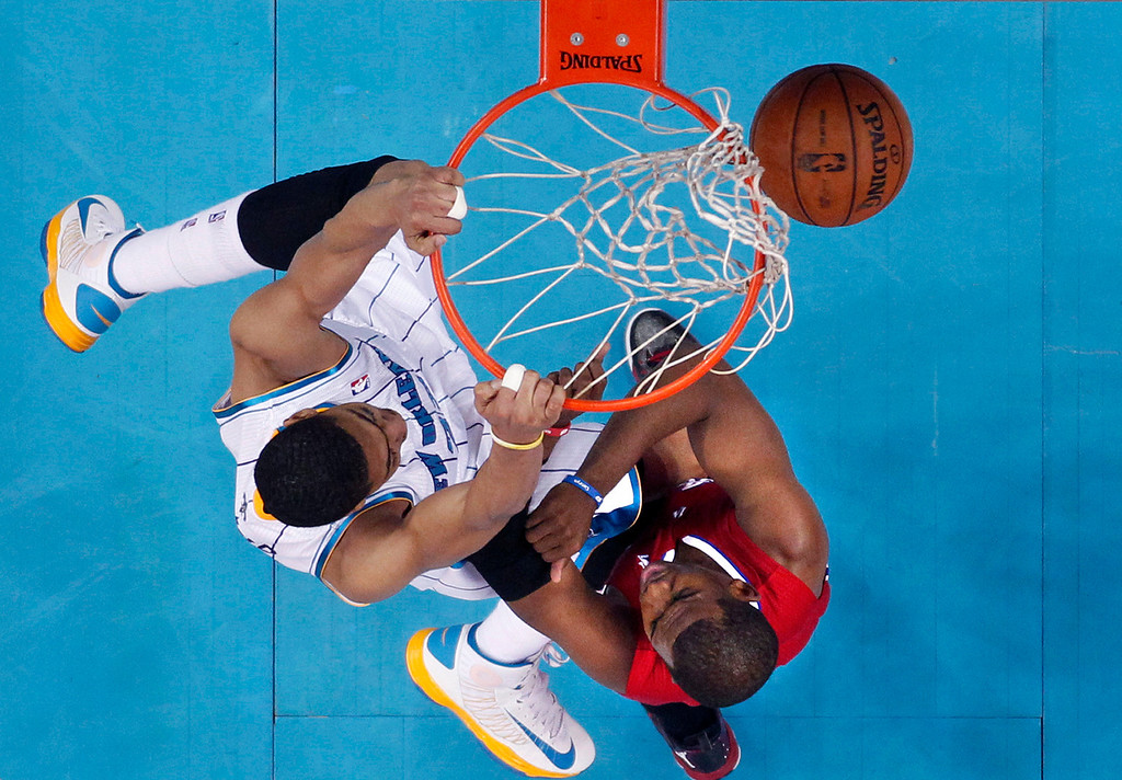 . New Orleans Hornets forward Anthony Davis dunks over Los Angeles Clippers guard Chris Paul, right, in the first half of an NBA basketball game in New Orleans, Wednesday, March 27, 2013. (AP Photo/Gerald Herbert)