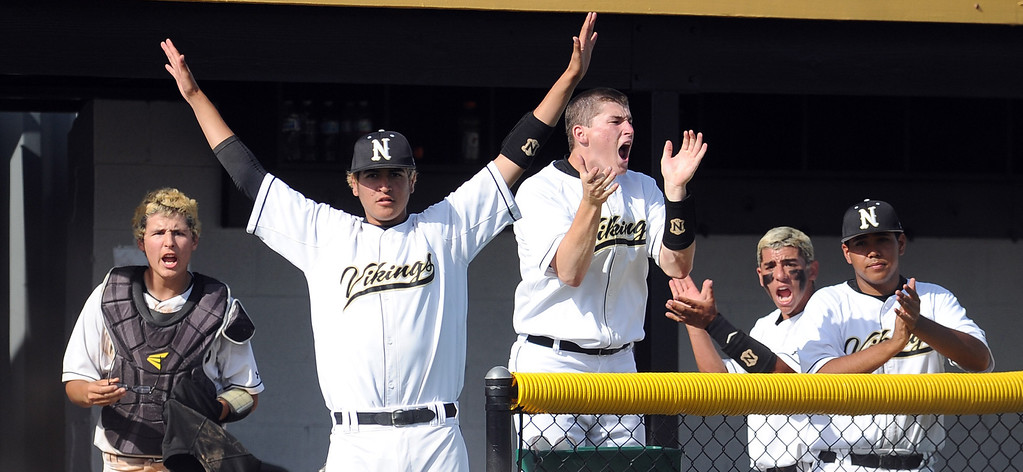 Description of . Northview reacts after scoring in the fourth inning of a prep baseball game against Baldwin Park at Northview High School on Tuesday, April 23, 2012 in Covina, Calif. Northview won 8-2.    (Keith Birmingham/Pasadena Star-News)