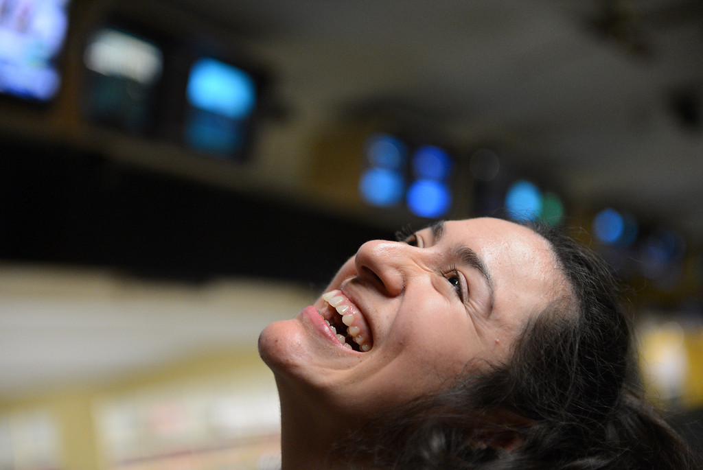. A happy smile floods Olivia\'s face as she watches her ball roll down the lane. Photo by Brad Graverson/LANG