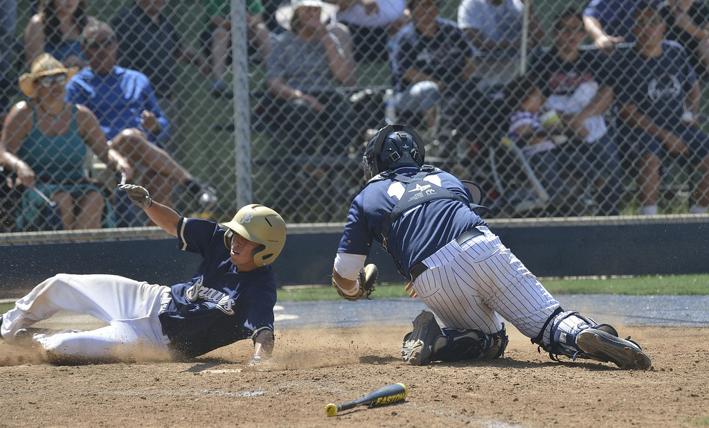 . SANTA FE SPRINGS, CALIF. USA -- St. John Bosco\'s Alec Rodriguez (3) is safe as he slides past St. Paul\'s Joe Argumedo (17) during their game at the St. Paul Tournament in Santa Fe Spring, Calif., on March 2, 2013. St. John Bosco defeated St. Paul, 4 to 2. Photo by Jeff Gritchen / Los Angeles Newspaper Group