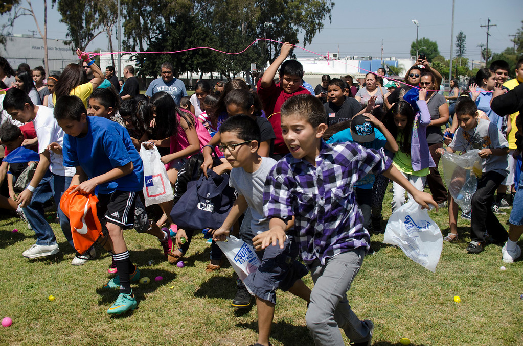 Description of . A crowd of children run into the field at Easter Land at Mayberry Park in South Whittier, Calif. Saturday, March 20, 2013. An expected crowd of 2,000 guest more than doubled for a helicopter drop of 5,000 Easter eggs. (SGVN/Correspondent photo by Anibal Ortiz)