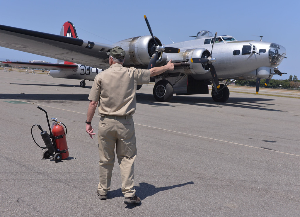. 0426_NWS_TDB-L-FLIGHT--- Torrance, CALIFORNIA--4/25/13--- Staff Photo: Robert Casillas / LANG--- The B-17 Bomber Aluminum Overcast visits Torrance Airport for flights and public viewing this weekend. Crew Chief gives thumbs up for plane to taxi to runway