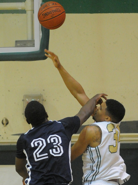 . 02-19-2012--(LANG Staff Photo by Sean Hiller)-Poly defeated Mayfair 73-28 in the second round of the Division I-AA boys basketball playoffs Tuesday night. Mayfair\'s William English (23) fouls Poly\'s Josh Jackson (34).