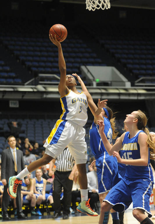 . 02-27-2012--(LANG Staff Photo by Sean Hiller)- Gahr vs. Agoura in Wednesday\'s girls basketball D3AAA title game at Anaheim Arena. Gahr\'s Jewelyn Sawyer (3) goes to the basket against Agoura\'s Brittany Mazal (44), center, and Kim Jacobs (15).