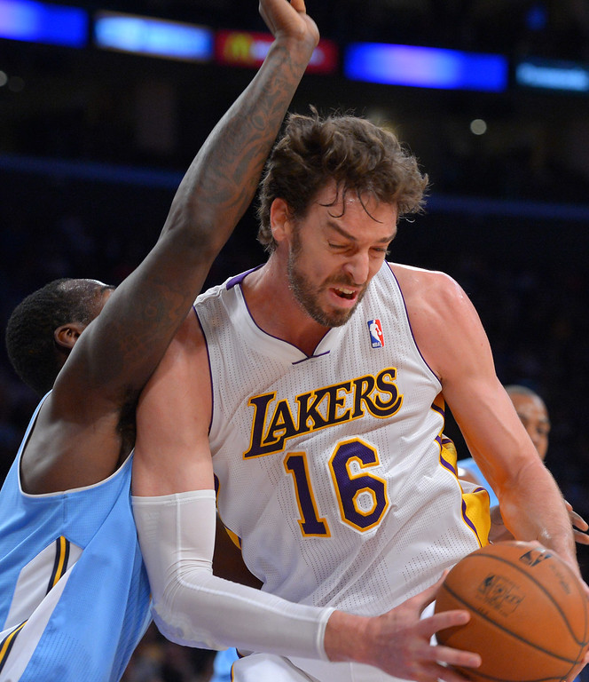. Lakers Pao Gasol pushes towards the basket as the Nuggets defend him at the Staple Center in Los Angeles, CA on Sunday, January 5, 2014. 1st half.  (Photo by Scott Varley, Daily Breeze)