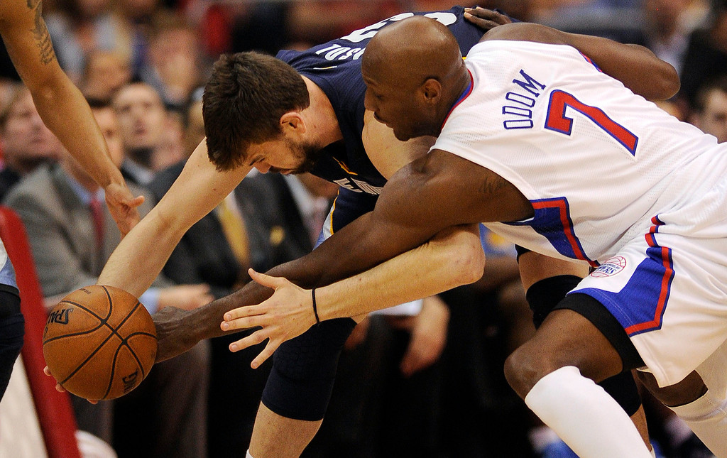 Description of . The Clippers' Lamar Odom #7 knocks the ball away from the Grizzlies' Marc Gasol #33 drawing the foul during their first round Western Conference Playoff game at the Staples Center in Los Angeles Saturday, April 20, 2013. (Hans Gutknecht/Staff Photographer)