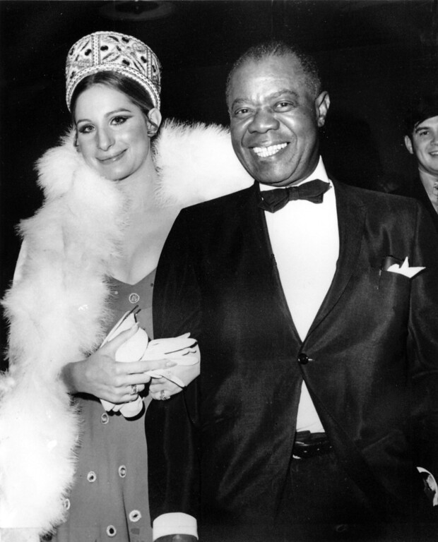 ". Barbra Streisand and Louis Armstrong arrive at the world premiere of the film ""Hello Dolly\"" in New York City on Dec. 17, 1969.  Both performers are starring in the movie version of the musical.  (AP Photo)"