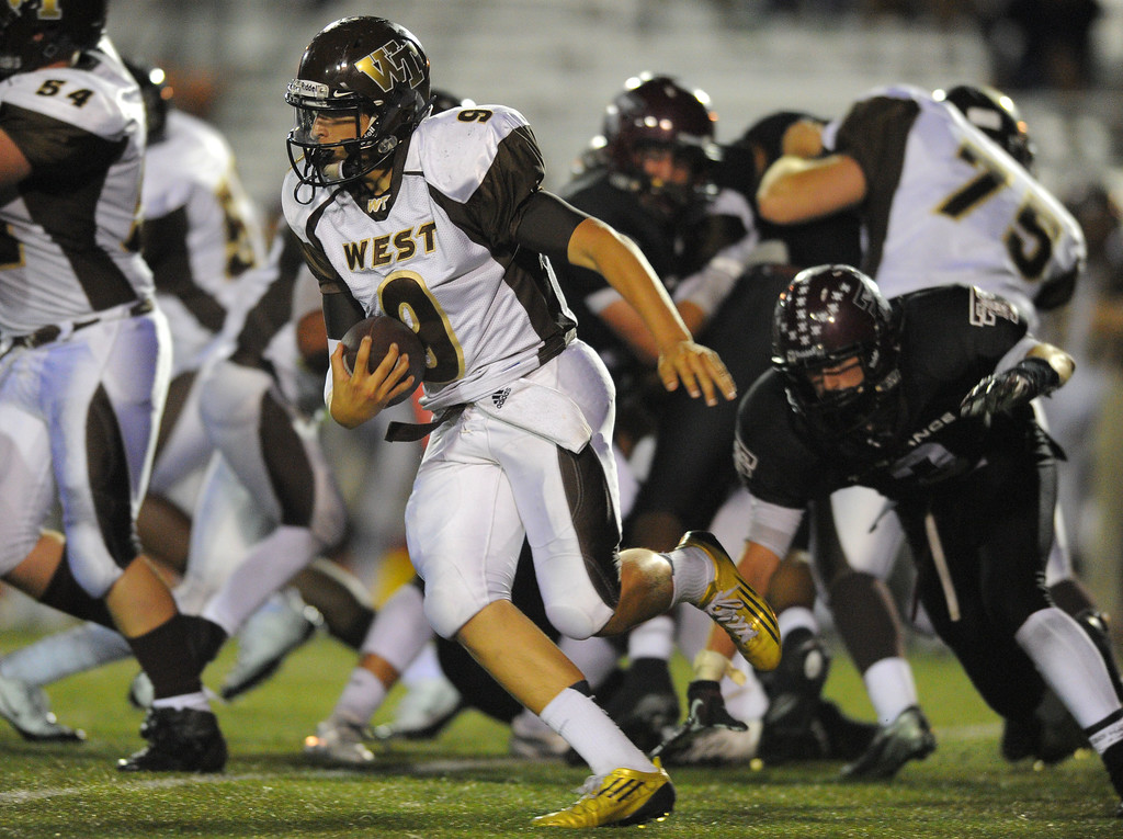 . West High takes on Torrance in a non league football game at Zamperini Stadium in Torrance, CA on Thursday, September 12, 2013. West won 46-7. West QB Trevor Mallett finds running room. (Photo by Scott Varley, Daily Breeze)