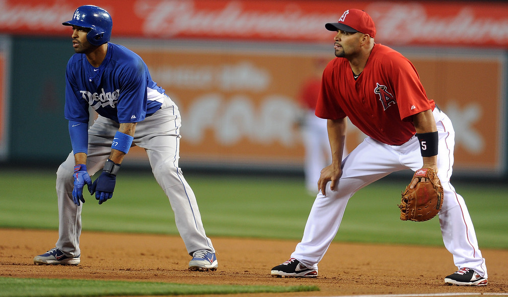 . Los Angeles Dodgers\' Matt Kemp leads off first as Los Angeles Angels first baseman Albert Pujols fields his position in the first inning of a spring baseball game on Thursday, March 28, 2012 in Anaheim, Calif.   (Keith Birmingham/Pasadena Star-News)
