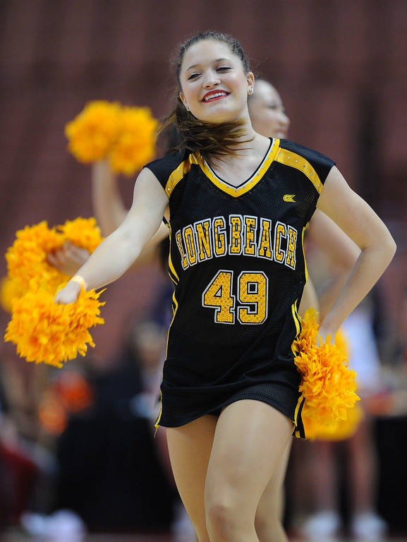 . LBSU cheerleaders perfomr during a timeout at the Honda Center in Anaheim, CA on Thursday, March 13, 2014. Long Beach State vs CSU Fullerton in the Big West men\'s basketball tournament. 2nd half. LBSU won 66-56.  Photo by Scott Varley, Daily Breeze)