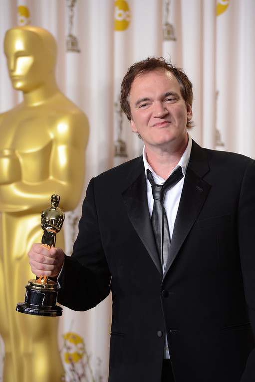 Description of . Quentin Tarantino accepts the award for best original screenplay for