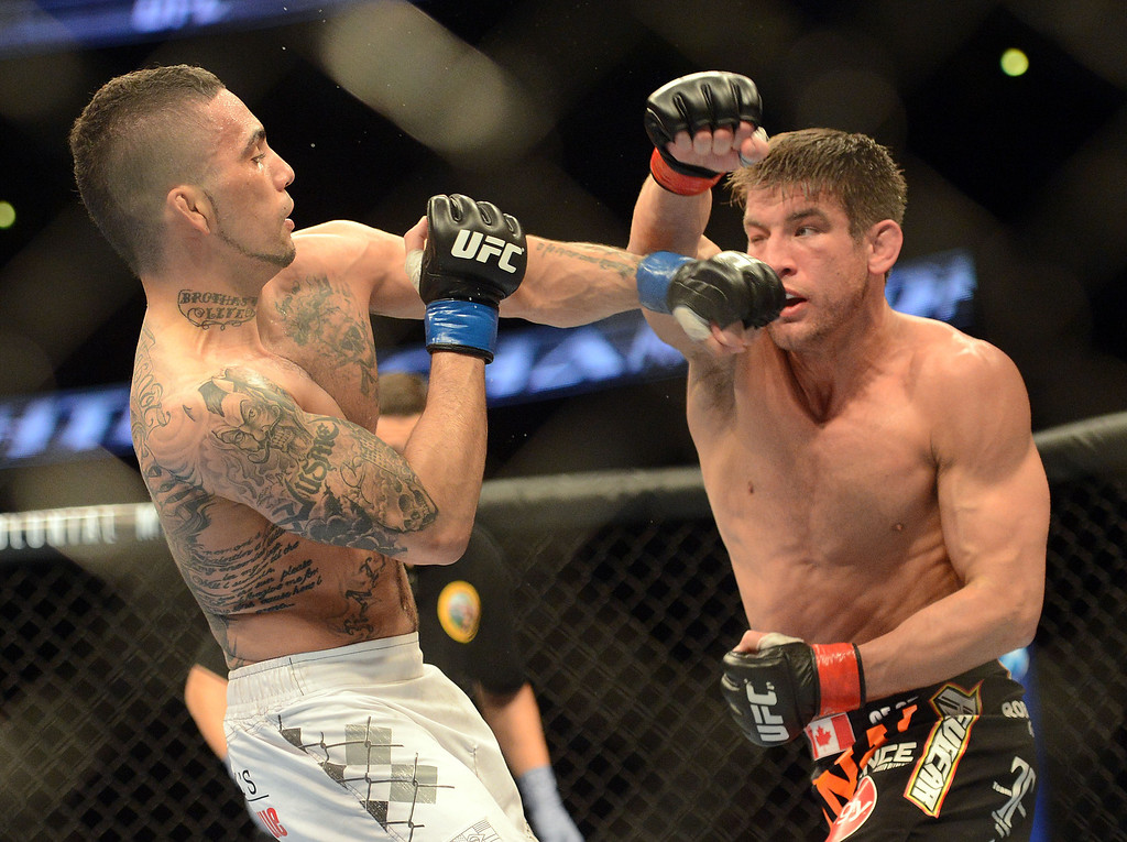 . Caros Fodor  and Sam Stout during their UFC 157 match at the Honda Center in Anaheim Saturday, February  23, 2013. Stout won via decision  (Hans Gutknecht/Staff Photographer)