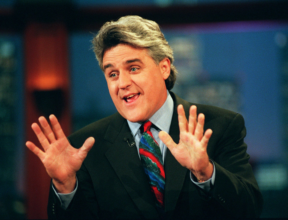 ". Jay Leno performs his monolog Sept. 30, 1996, on ""The Tonight Show with Jay Leno\"" in Burbank, Calif. Leno has written a new book, \""Leading with My Chin,\"" which he says is not an autobiography. (AP Photo/Mark J. Terrill)"