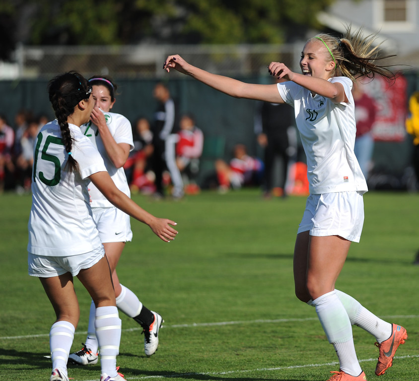. 02-21-2012--(LANG Staff Photo by Sean Hiller)- South Torrance girls soccer beat Artesia 5-0 in Thursday\'s CIF Southern Section Division IV quarterfinal at South High. Kyla Diekmann celebrates her third goal to complete a hat trick as she runs to teammates Noelle Ly (15), left, and Jessica Nakae (27), center, in the first half.