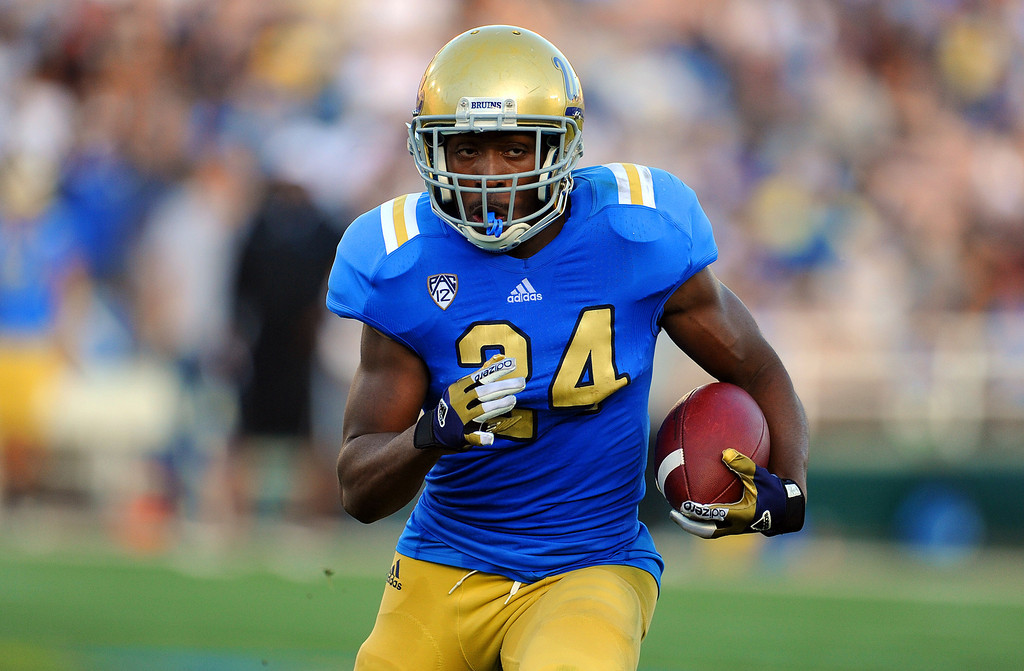 Description of . UCLA running back Paul Perkins (24) during the football spring showcase college football game in the Rose Bowl on Saturday, April 27, 2013 in Pasadena, Calif.    (Keith Birmingham Pasadena Star-News)