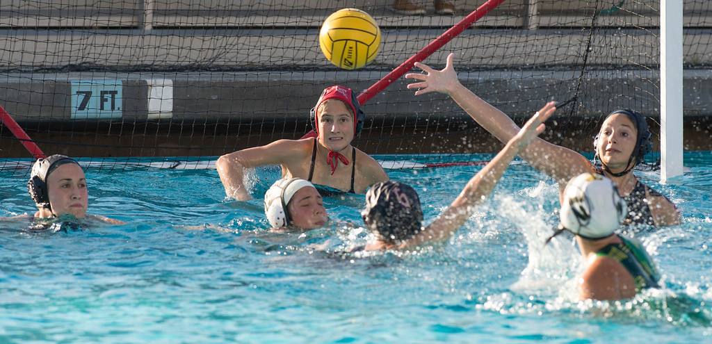Description of . La Serna High goalie Jacqui Verdugo readies to block a Temple City High shot on goal during the CIF-SS girls water polo first-round game at Whittier High Feb. 14, 2013.   (SGVN/Staff photo by Leo Jarzomb)