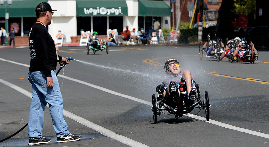 Description of . Greg Johnson of Loma Linda sprays down cyclists in PossAbilities Paracycle Criterium Sunday April 7, 2013 during the Redlands Bicycle Classic. Johnson who suffered a spinal chord injury nearly 30 years ago says he offers to spray down the cyclists because