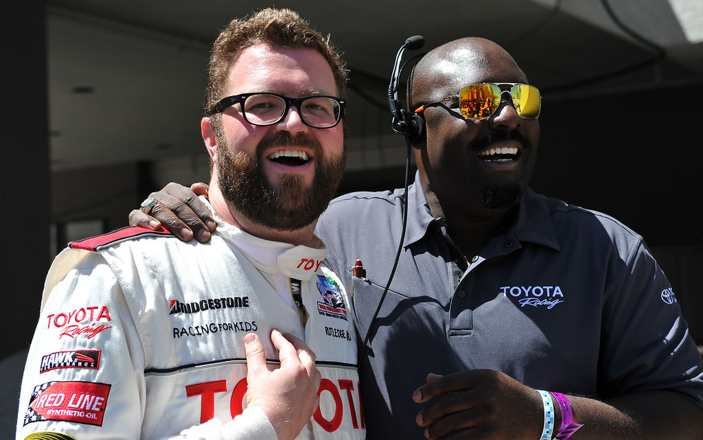 . 4/19/13 - Prankster, and funny man, Rutledge Wood tries to charm Andre Jackson into letting him see Trucco\'s damaged car after the Friday morning practice of the Toyota Pro/Celebrity race at the 39th Annual Toyota Grand Prix of Long Beach. Photo by Brittany Murray / Staff Photographer